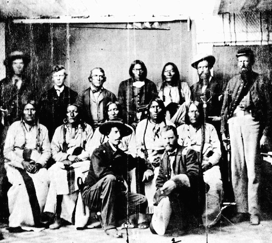 Camp Weld Conference 9/28/1864. Ned Wynkoop and Silas Soule, front row. Chief Black Kettle is behind Wynkoop (Wikimedia Commons)